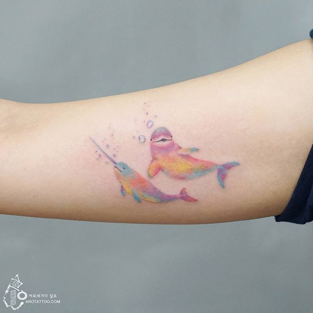 Pastel Dolphins Arm Tattoo