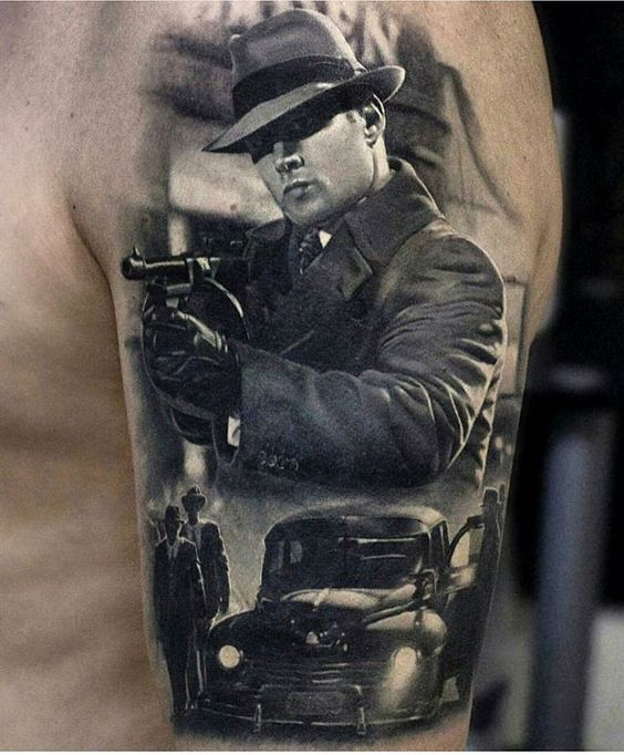 Man With A Gun Arm Tattoo