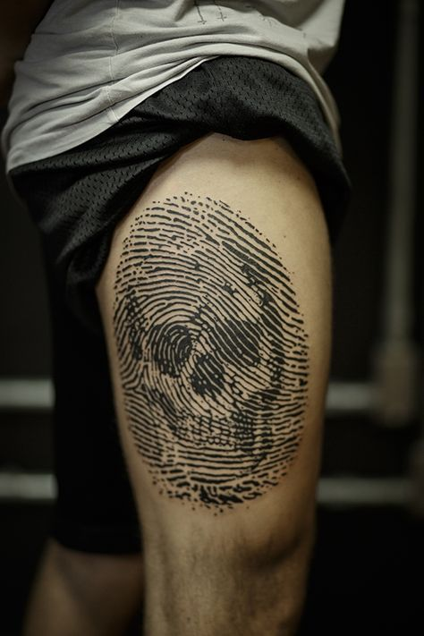 Segmented Skull Thigh Tattoo