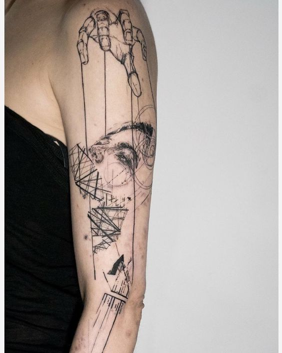 Abstract Puppetry Arm Tattoo