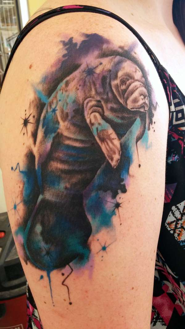 Color Splashed Manatee Arm Tattoo