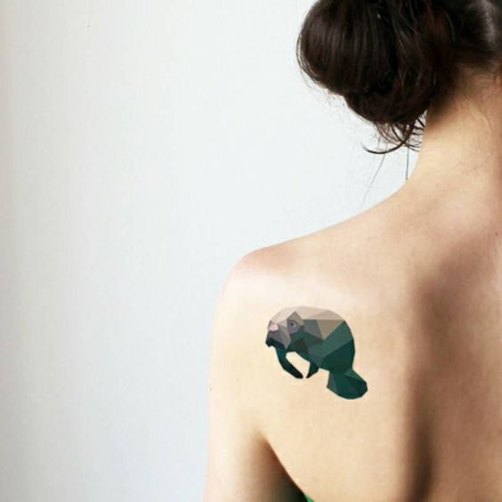 Geometric Manatee Back Tattoo