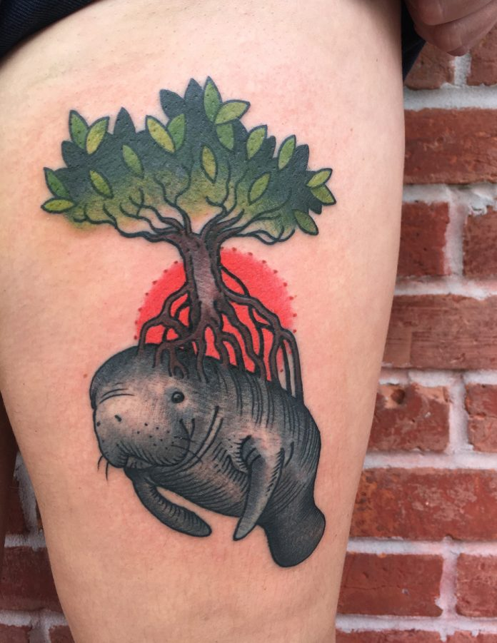 Nature And Manatee Thigh Tattoo