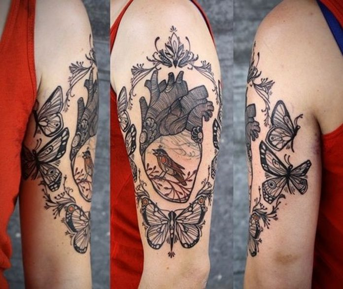 Ornamental Framed Heart Arm Tattoo