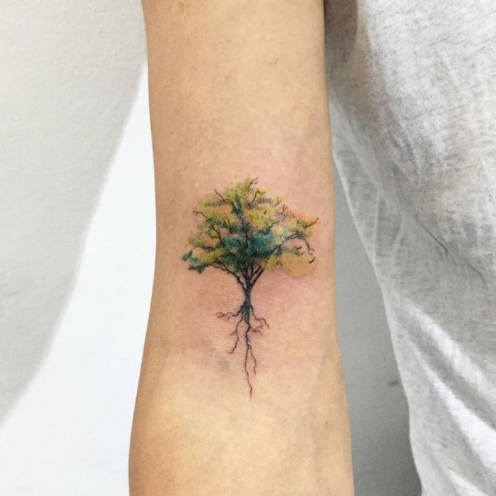 Subtle Tree Roots Forearm Tattoo
