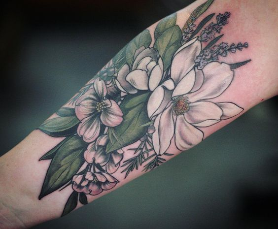 Magnolia Bouquet Forearm Tattoo