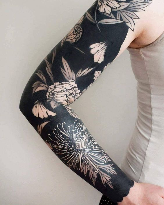 Negative Space Chrysanthemum Arm Tattoo