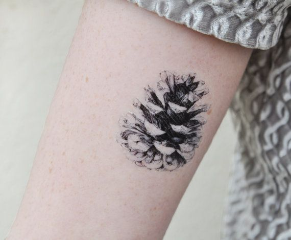 White And Black Ink Pine Cone Arm Tattoo