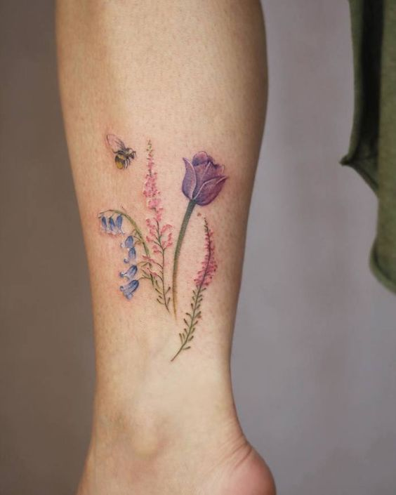 Subtle Wildflower With Bee Leg Tattoo