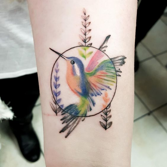 Colored Centered Hummingbird Forearm Tattoo