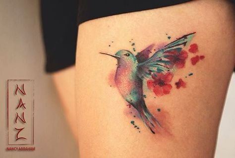 Feminine Hummingbird Thigh Tattoo