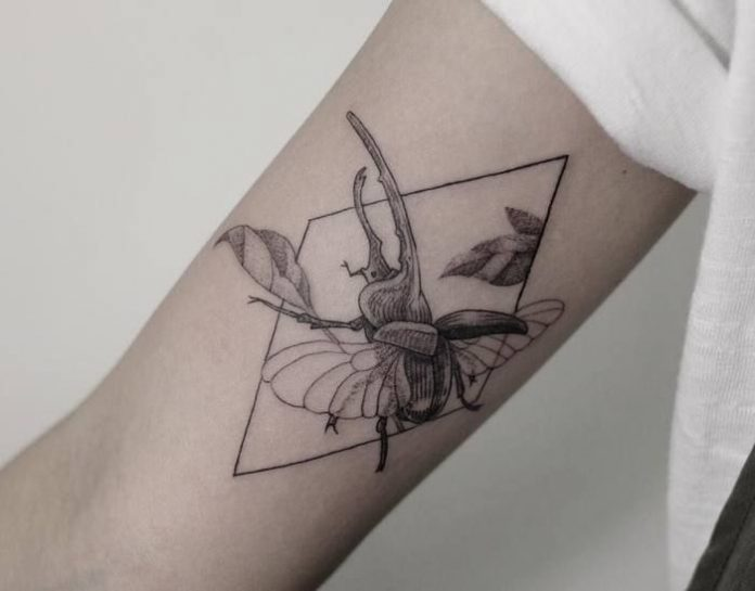 Fine Geometric Beetle Arm Tattoo