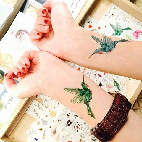 Green And Blue Hummingbird Wrist Tattoos