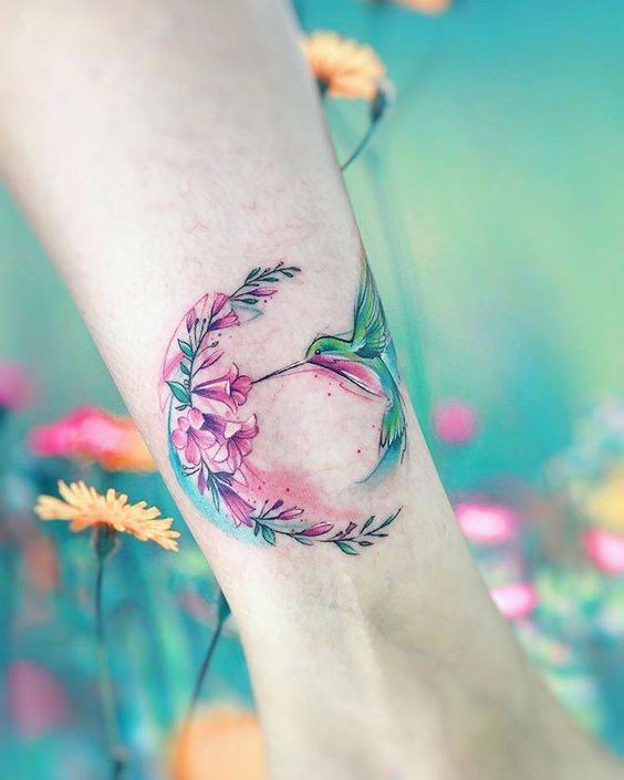 Hummingbird And Floral Wreath Forearm Tattoo