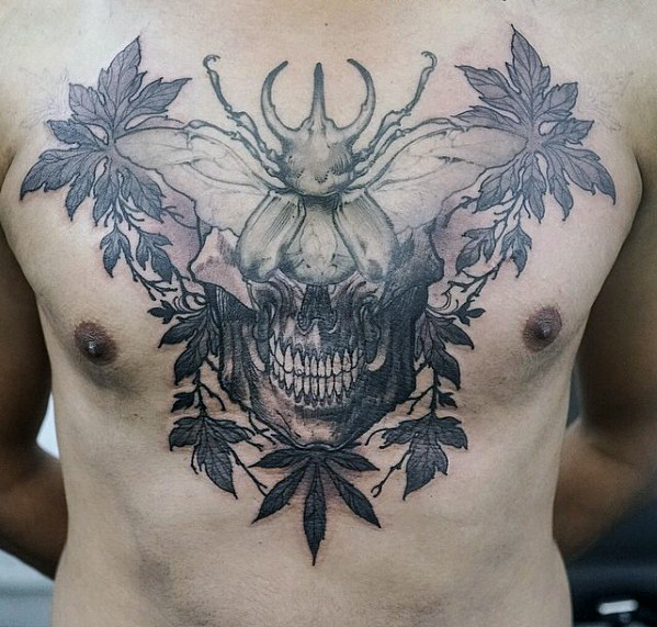 Skull With Beetle Chest Tattoo