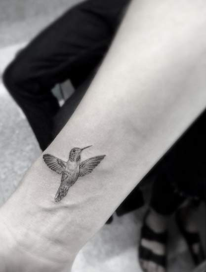 Subtle Hummingbird Wrist Tattoo