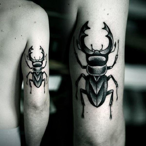 Tribal Beetle Arm Tattoo