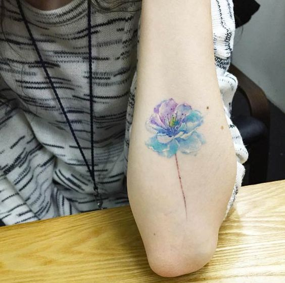 Two Toned Watercolor Flower Arm Tattoo