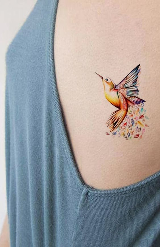 Vibrant Hummingbird Side Tattoo