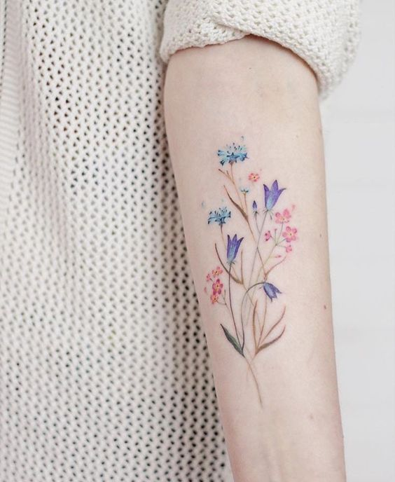 Watercolor Wildflowers Arm Tattoo