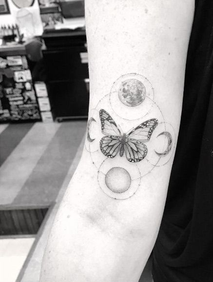 Cosmic Butterfly Arm Tattoo