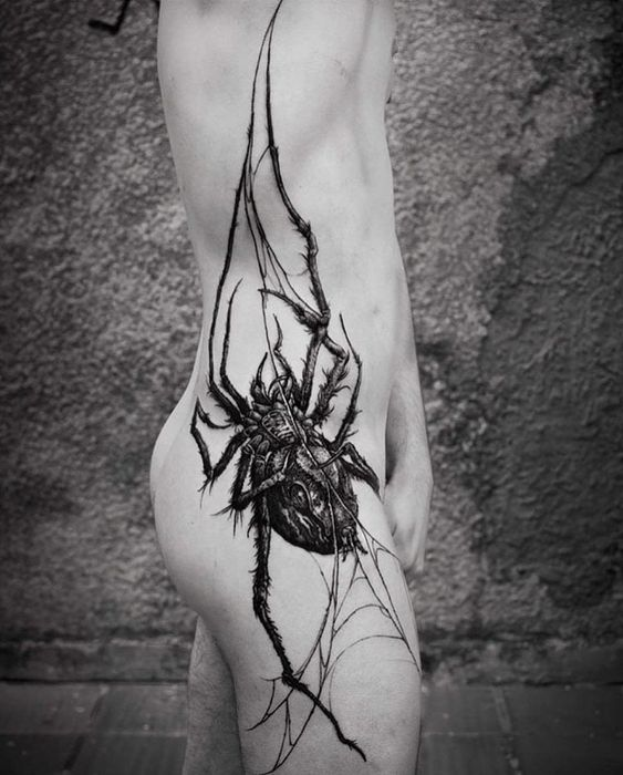 Huge Spider On A Web Side Tattoo