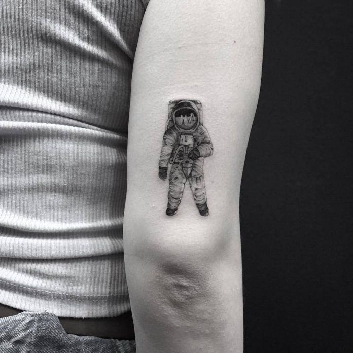 Single Needle Astronaut Arm Tattoo