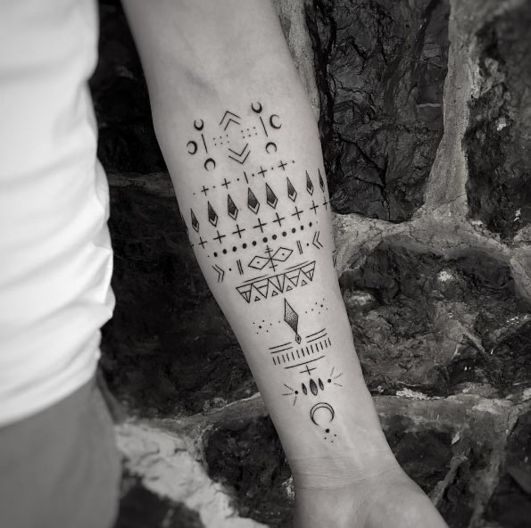 Tribal Symbols Forearm Tattoo