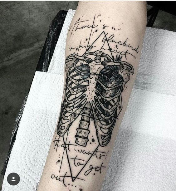 Typographic Ribcage Tattoo