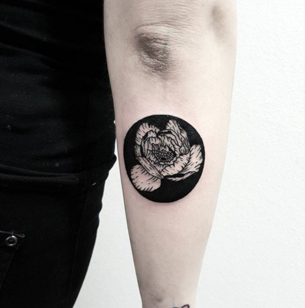 Negative Space Flower Circle Tattoo