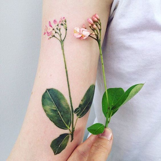 Lovely Pink Flowers Arm Tattoo