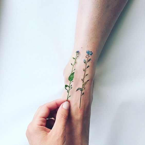 Tiny Blue Flowers Ankle Tattoo