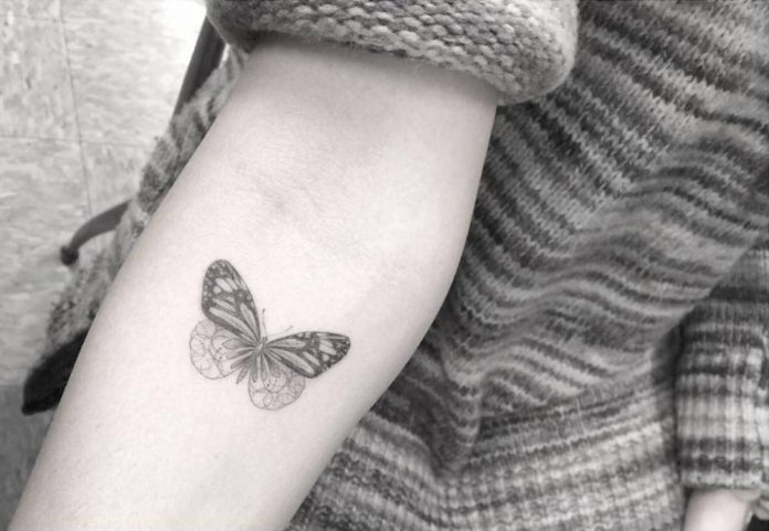 Tiny Butterfly Forearm Tattoo