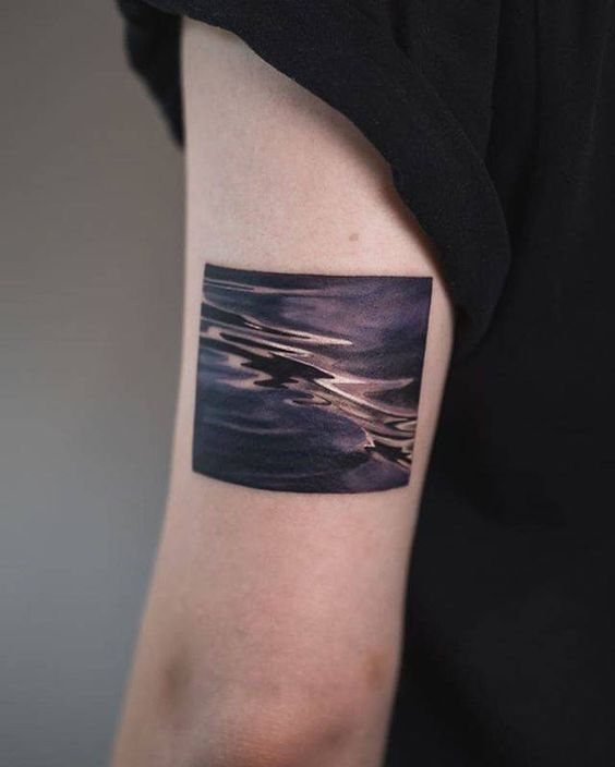 Black Water Arm Tattoo