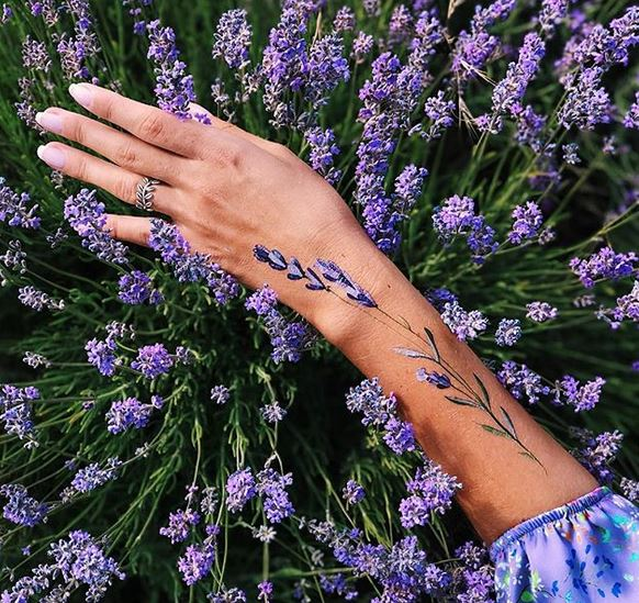Lavender Bloom Arm Tattoo