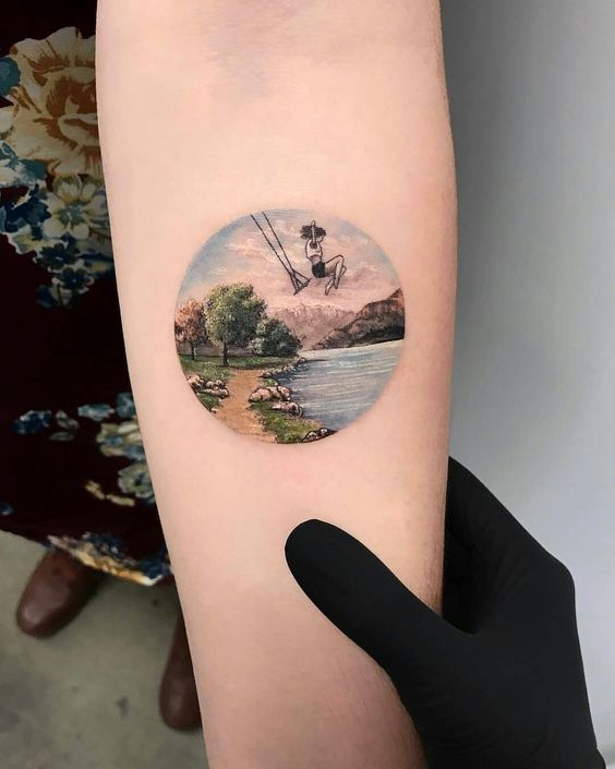 Swinging Lady Forearm Tattoo