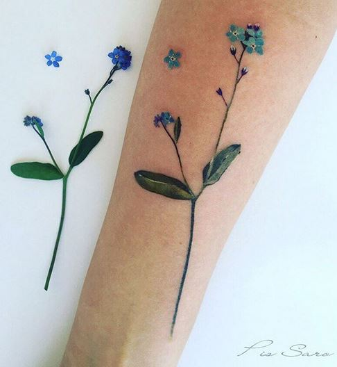 Tiny Blue Flowers Forearm Tattoo