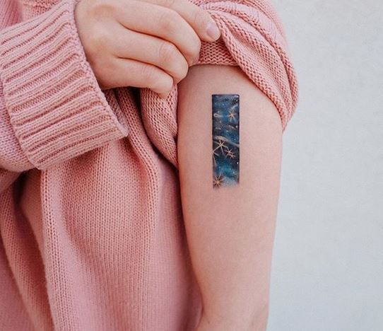 Cosmic Themed Arm Tattoo