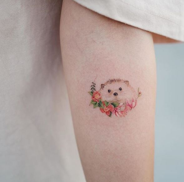 Floral Hedgehog Forearm Tattoo