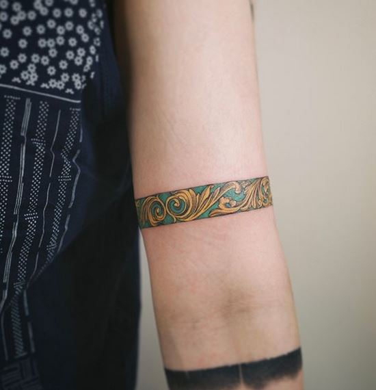Gold Ornamental Arm Band Tattoo