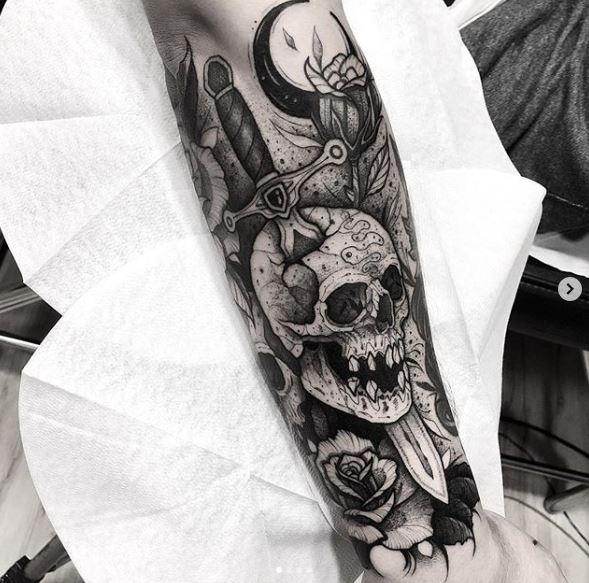 Dagger Pierced Skull Arm Tattoo