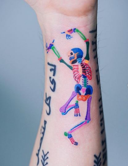 Dancing Skeleton Forearm Tattoo