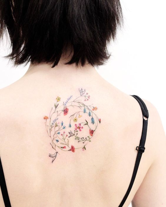 Delicate Botanical Back Tattoo
