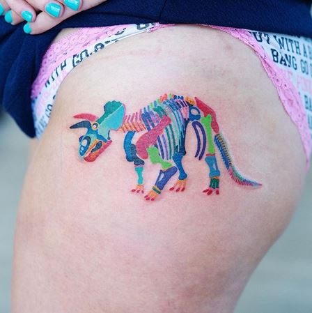Dinosaur Skeleton Thigh Tattoo