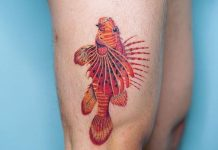Intricate Fish Thigh Tattoo