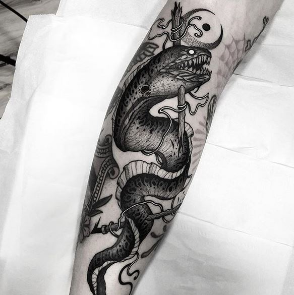 Trapped Eel Leg Tattoo