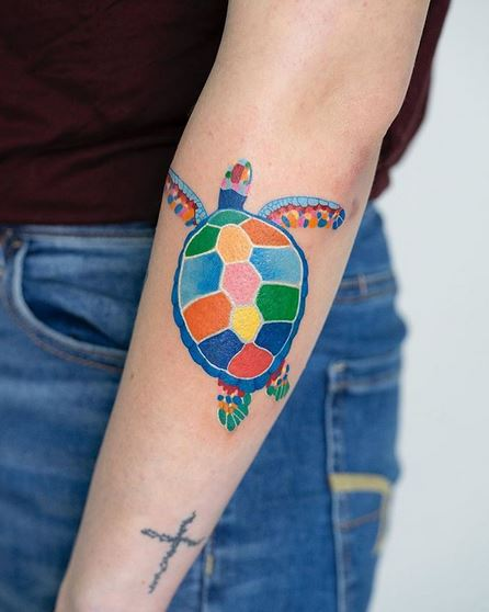 Vibrant Turtle Forearm Tattoo
