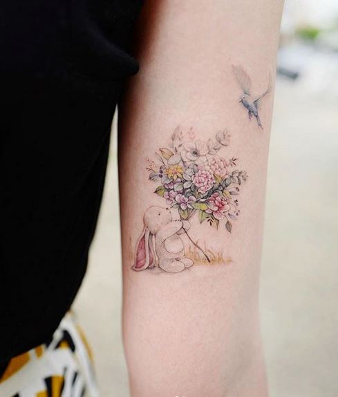Bunny With Flowers Arm Tattoo