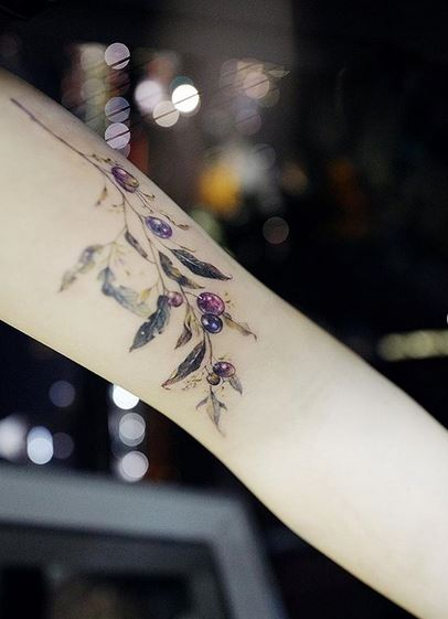 Olive Arm Tattoo